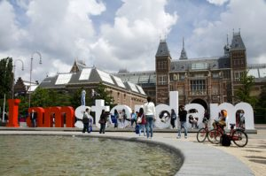 editorial tourists playing on i amsterdam sign in front of rijksmuseum amsterdam holland